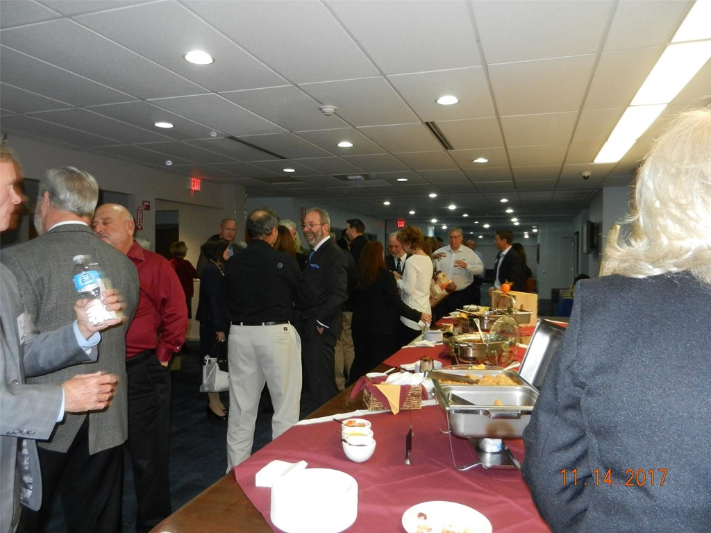 Buffet table and crowd attending the business card exchange held at the Bucks IU