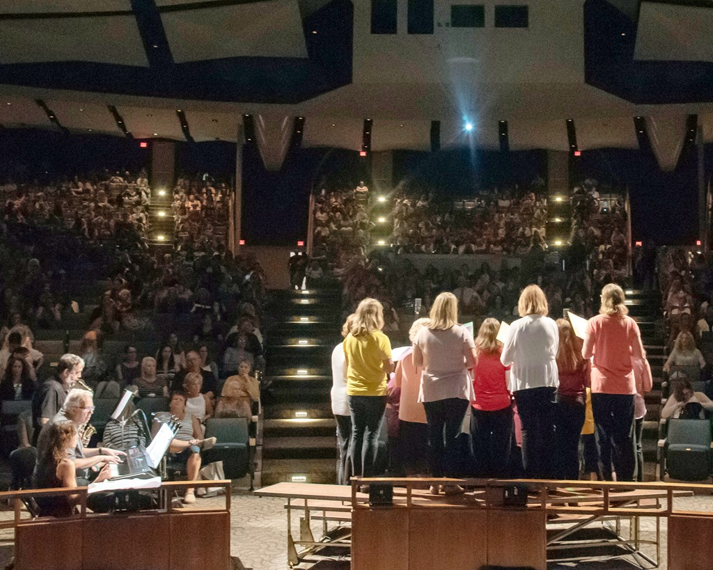The Bucks IU Choir facing the audience on Opening Day 2018