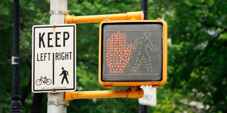 Crosswalk signal along with sign for pedestrians and bicycles.