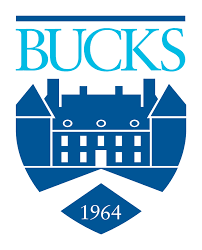 Bucks County Community COllege logo with name, date of incorporation, and building in a shield design.